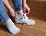 Footies wit aantrekken
